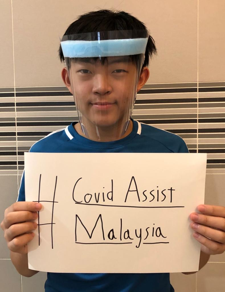 SJIIM Student Calvin Foo with one of the face shields he made for COVID Assist Malaysia